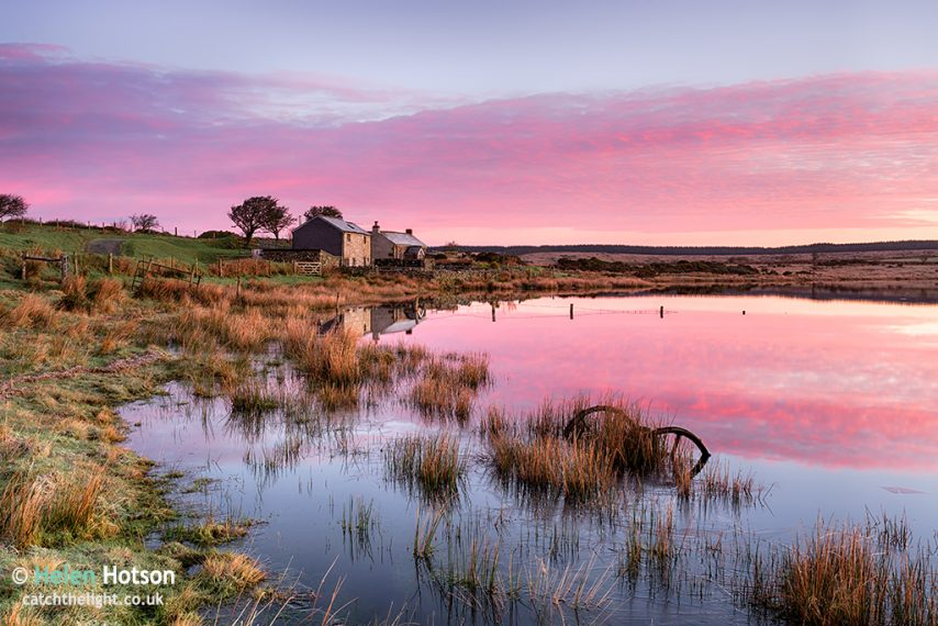 Stunning sunrise over Dozmary Pool on Bodmin Moor in Cornwall, a small natural lake steeped in Arthurian legend and reputedly the haunt of the Lady of the Lake